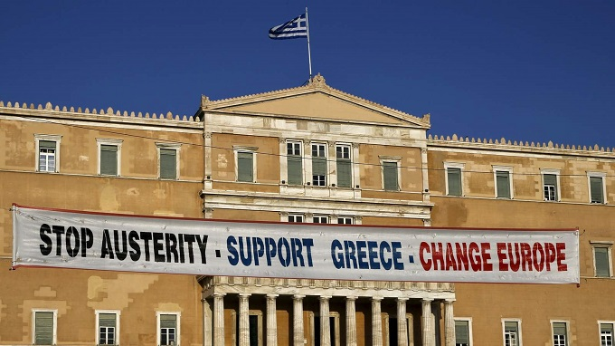 A banner hangs in front of the parliament during a rally in support of Greece's government in Athens